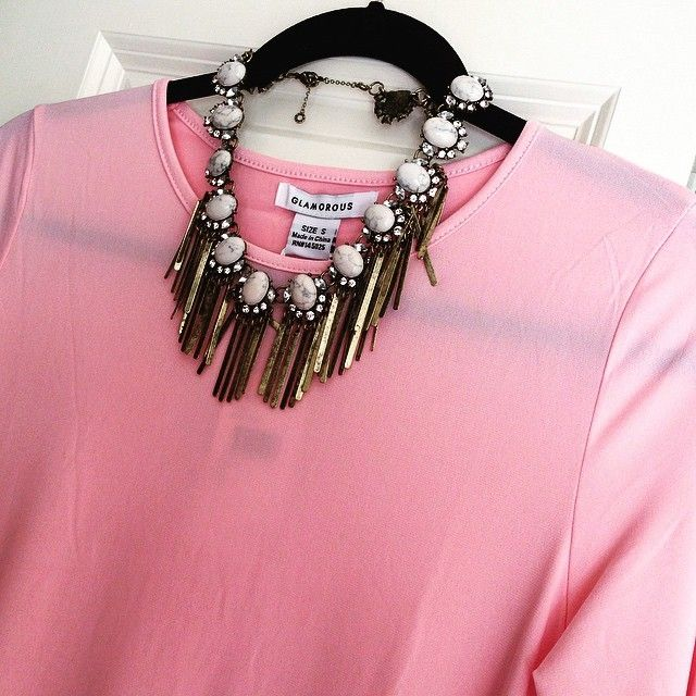 pink dress and statement necklace