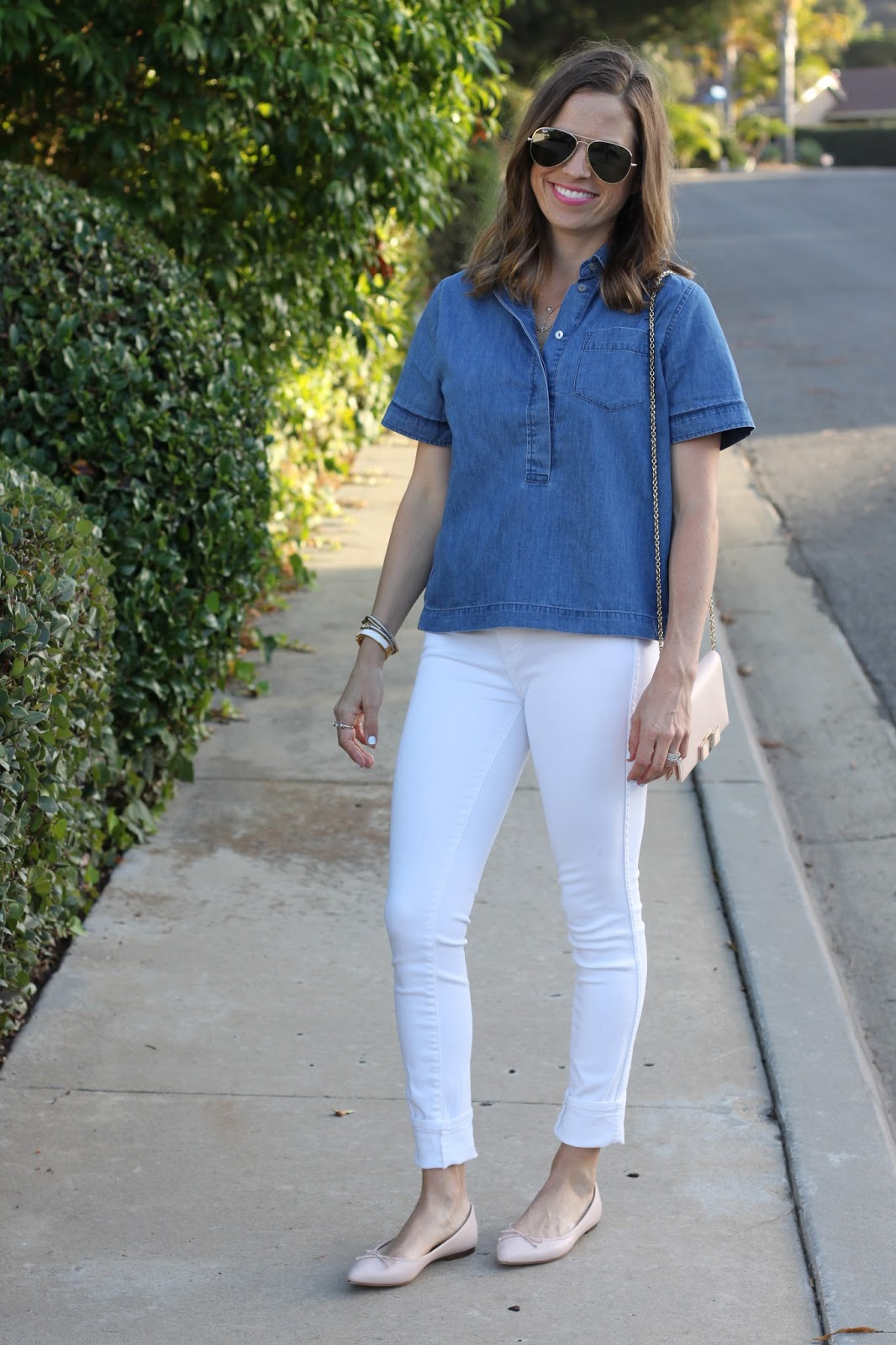 denim shirt and white skinny jeans
