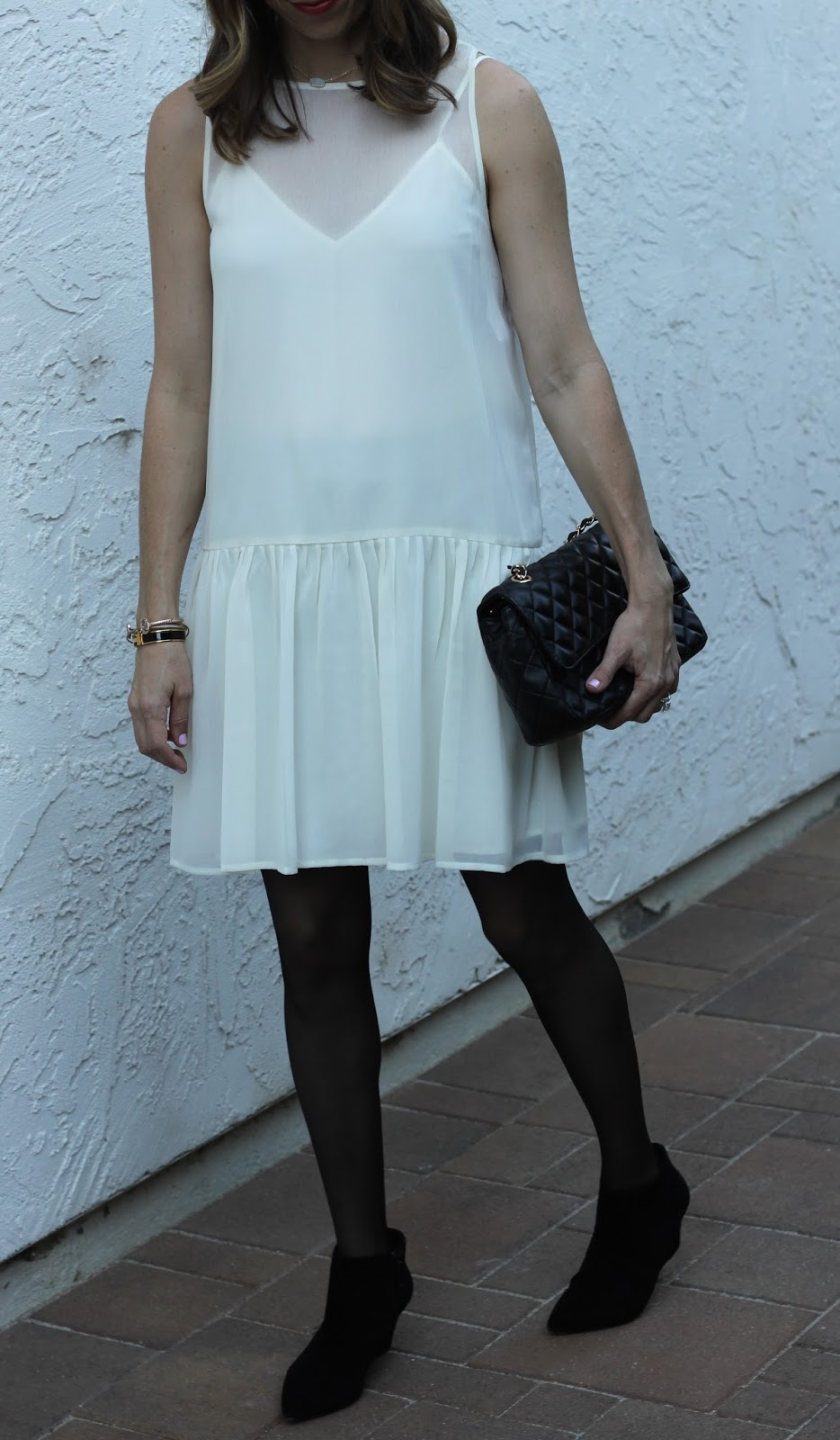black booties and chanel white dress