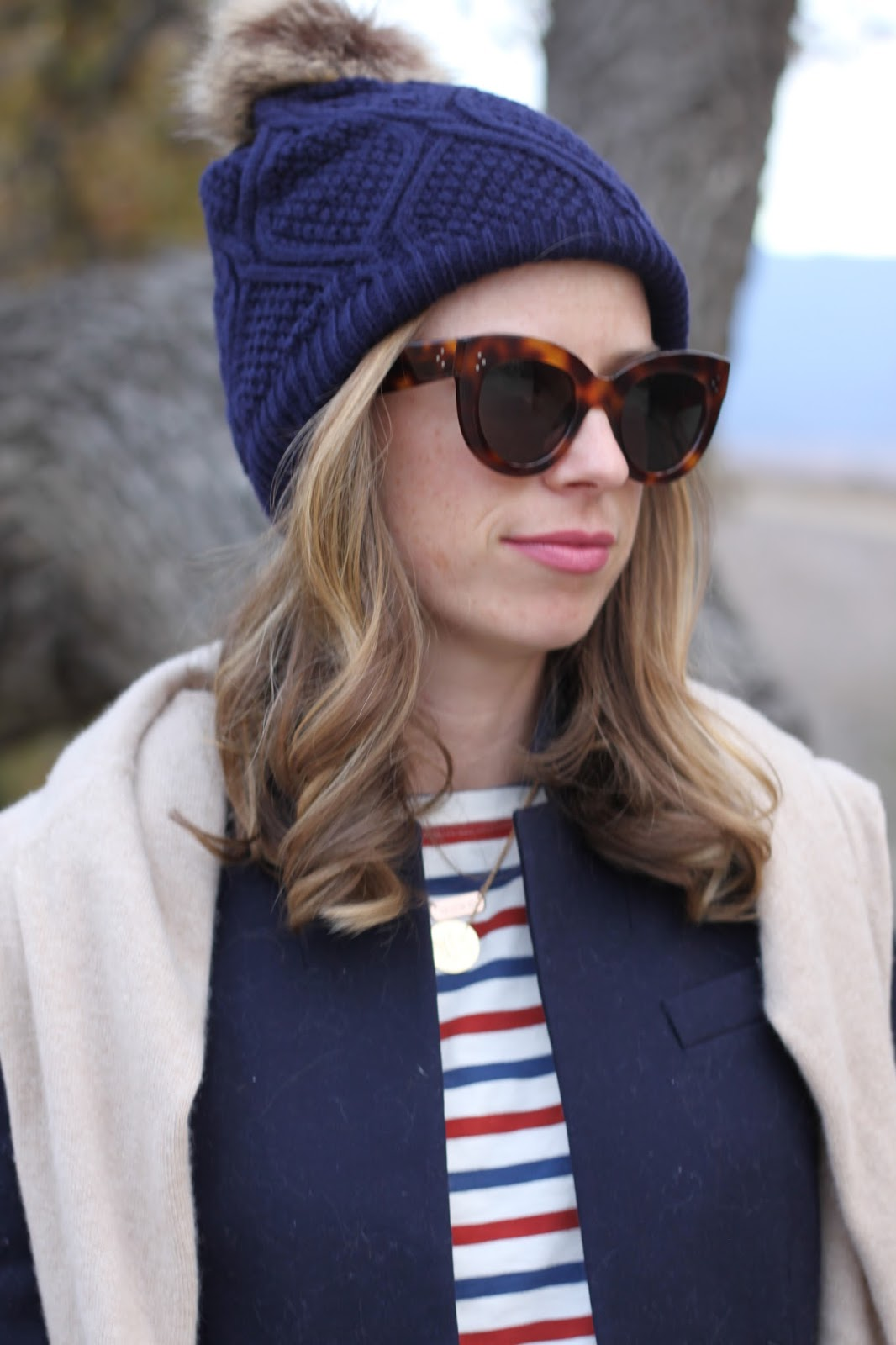 pom beanie and celine sunglasses