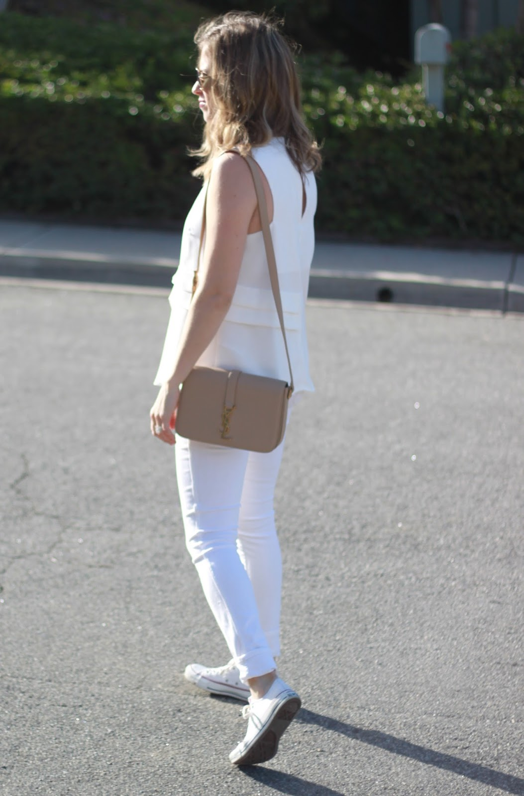 all white outfit and nude bag