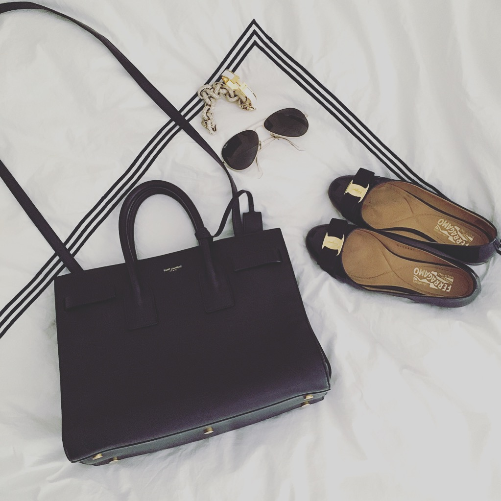 navy designer bag and shoes
