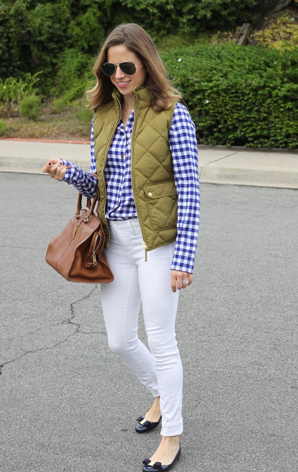 j.crew excursion vest and white skinny jeans
