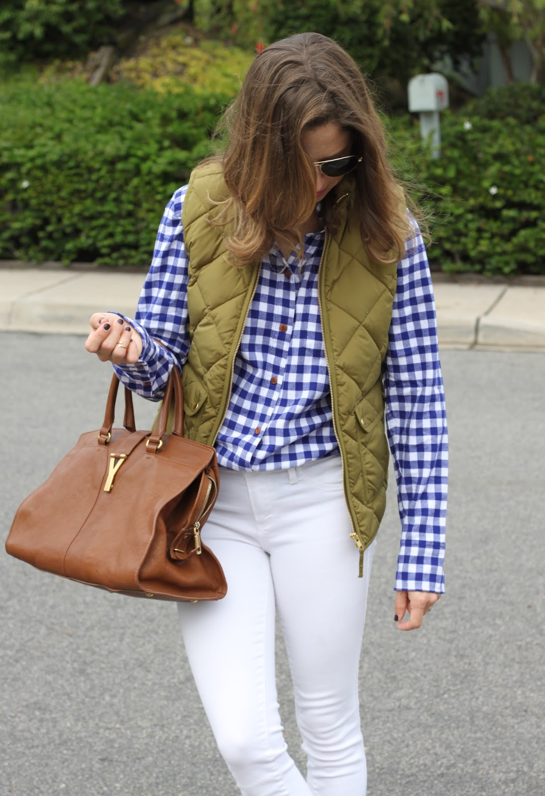 gingham shirt excursion vest and white skinny jeans