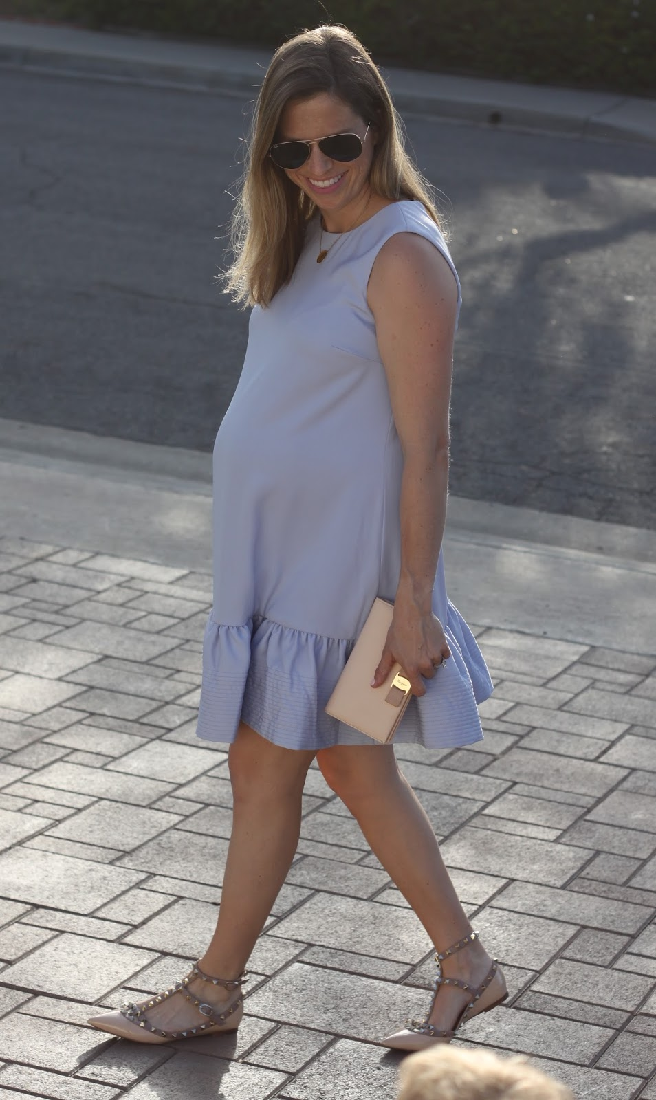 pink rockstuds and maternity dress