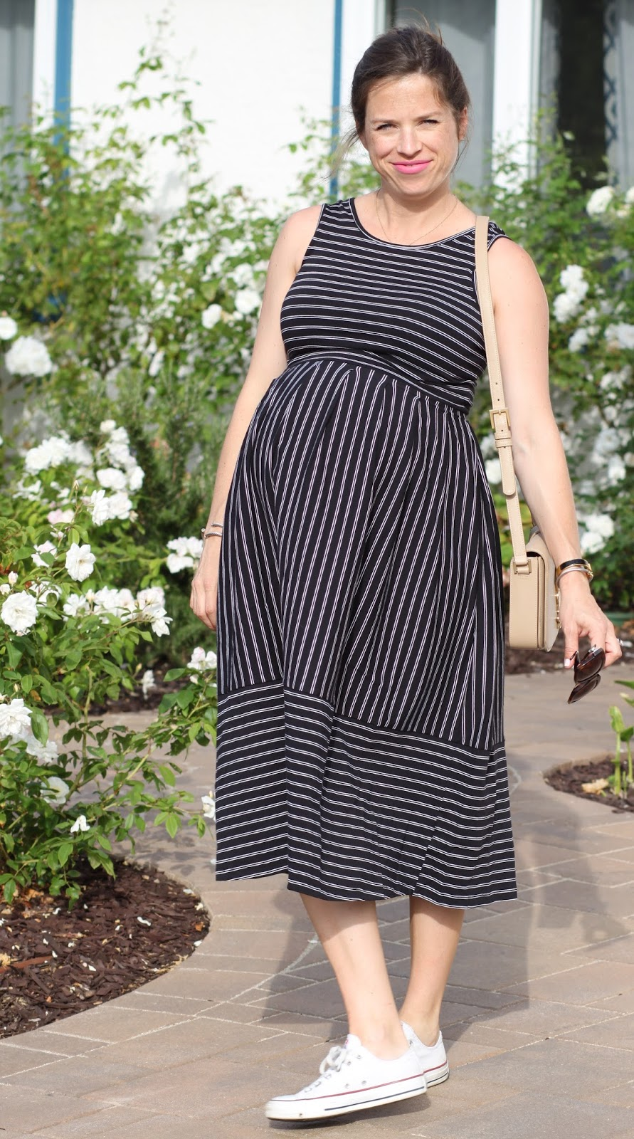 black maternity dress and sneakers