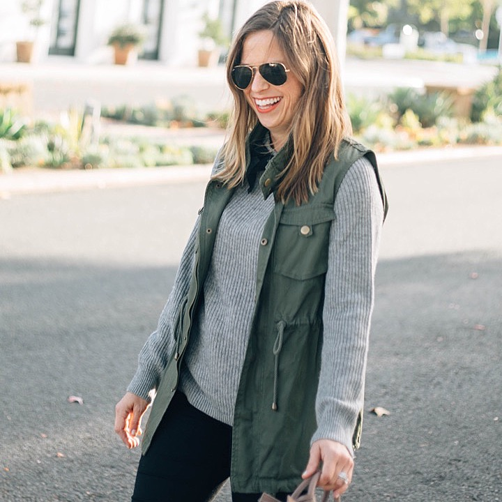 army green vest and sweater