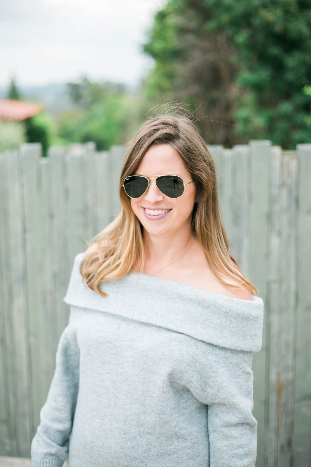 off the shoulder sweater and sunglasses