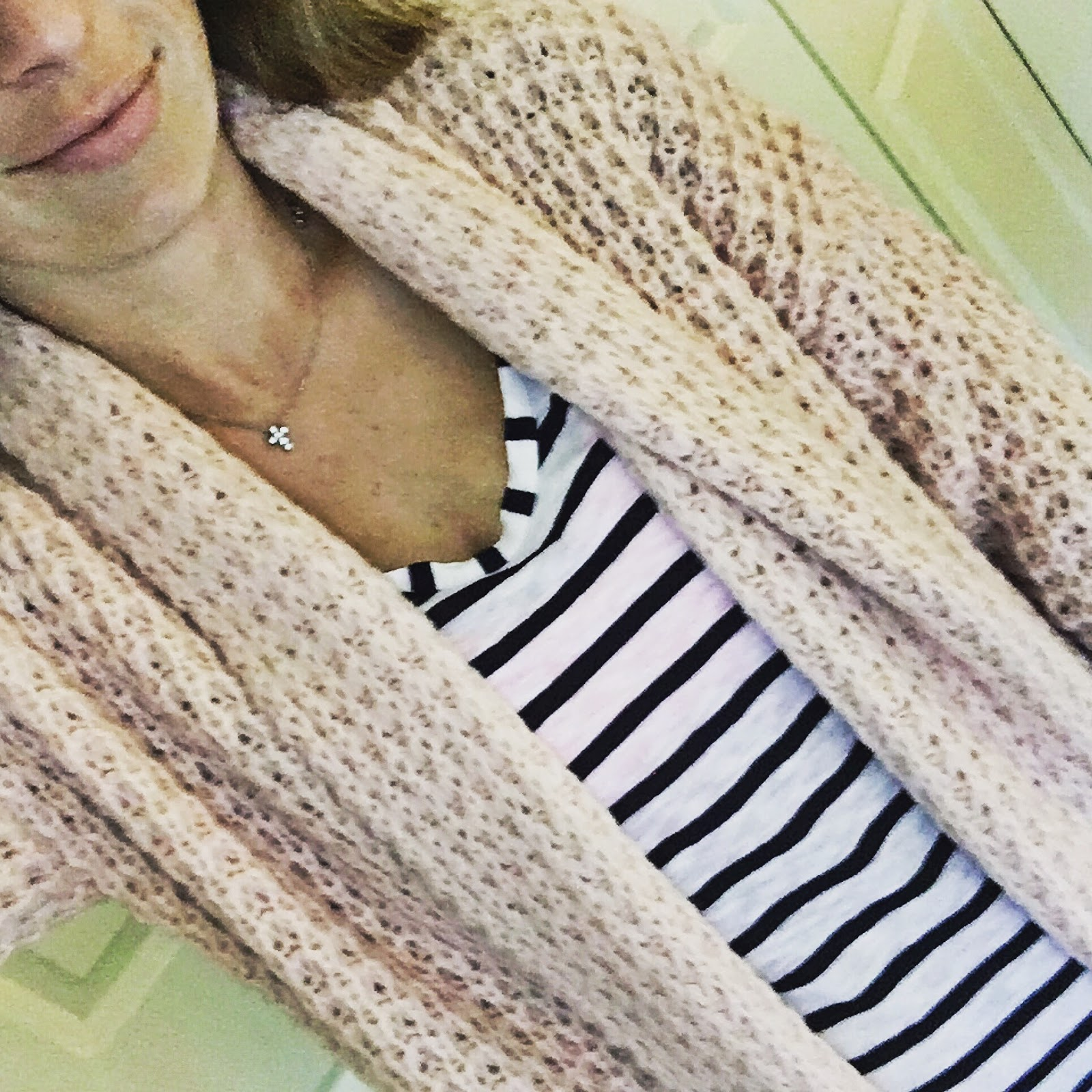 blush oversized sweater and stripes