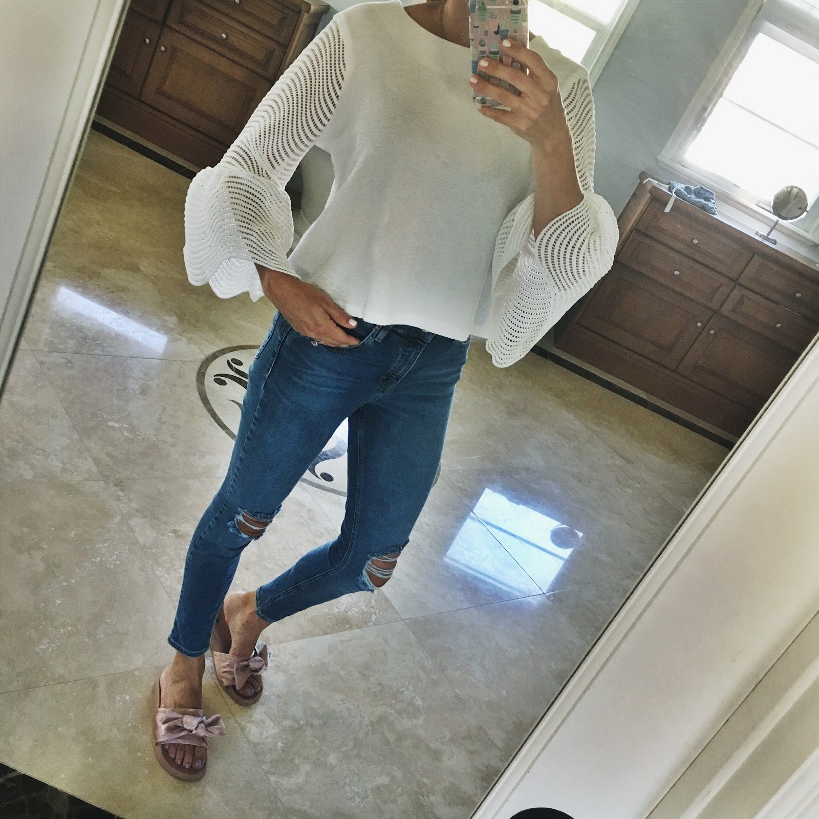 white bell sleeves and high waisted skinny jeans outfit