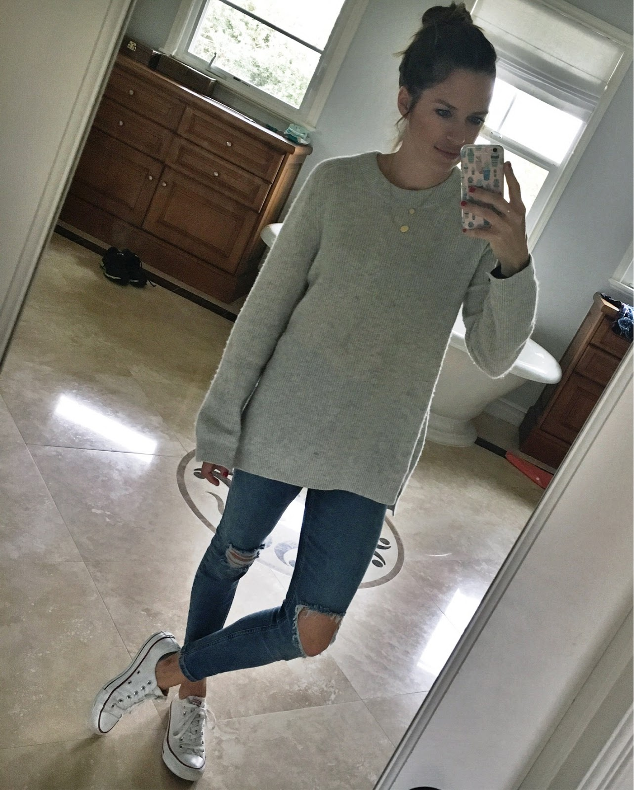 cashmere sweater and ripped jeans