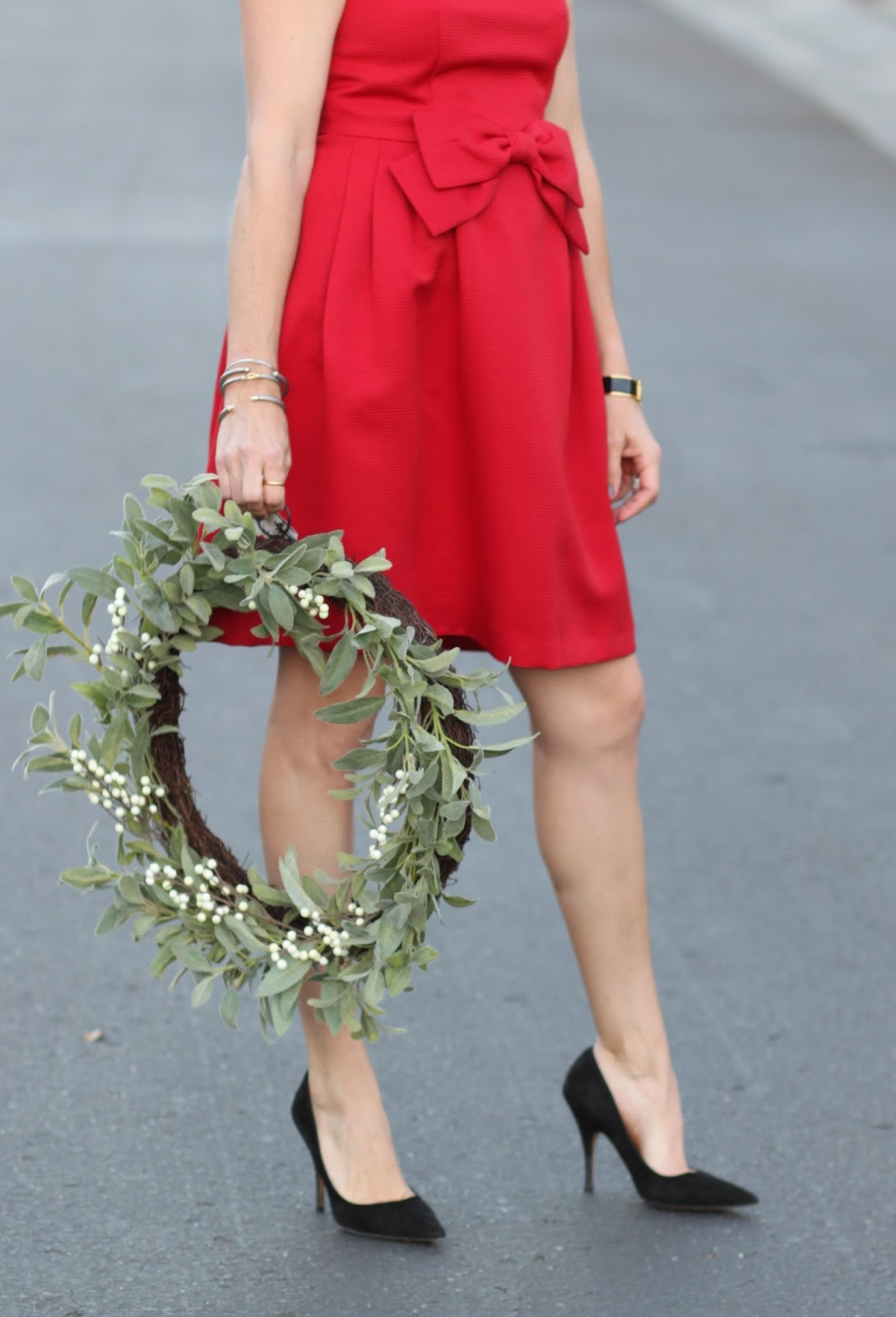 magnolia wreath and holiday outfit