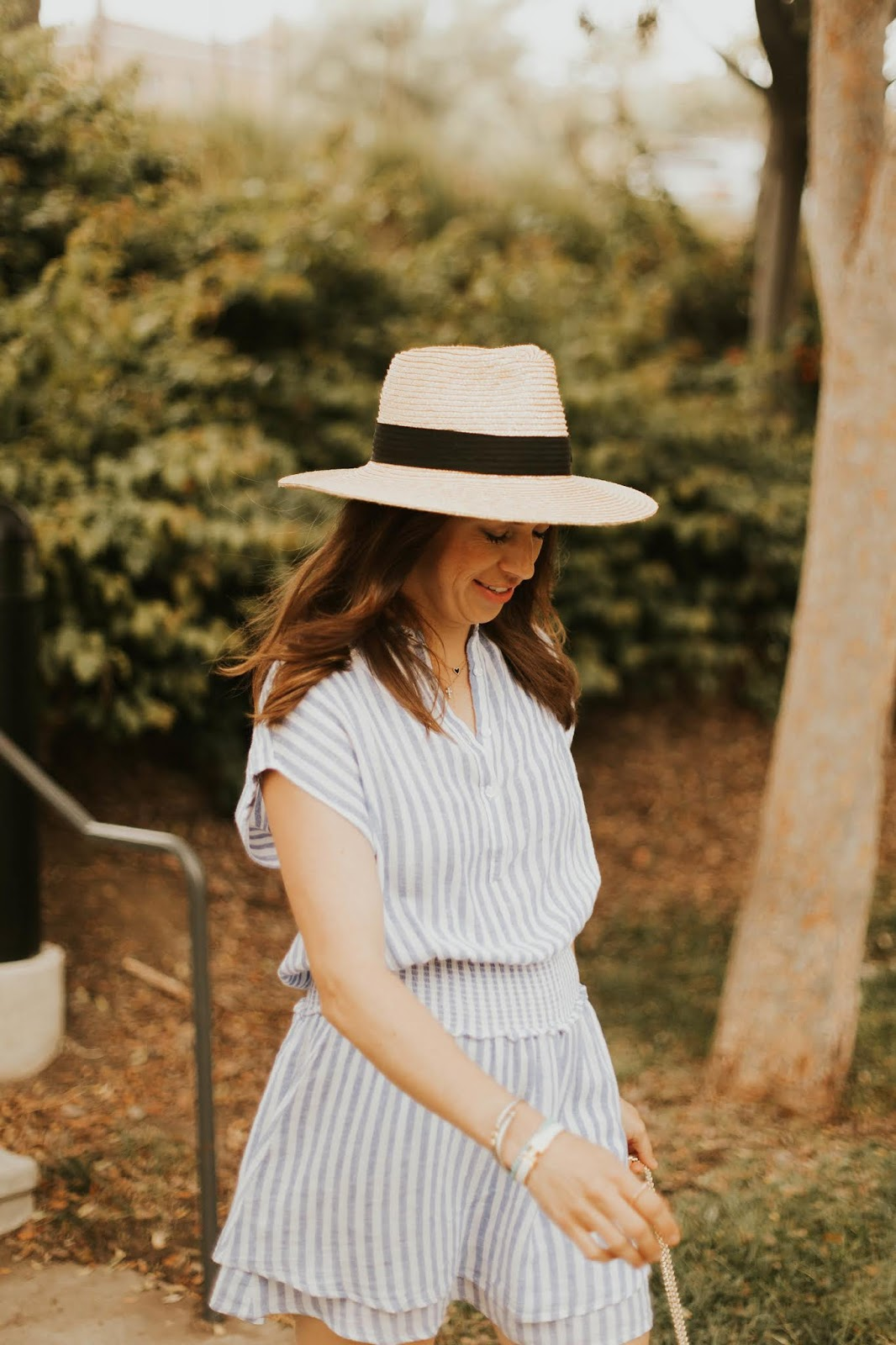 striped dress and straw fedora