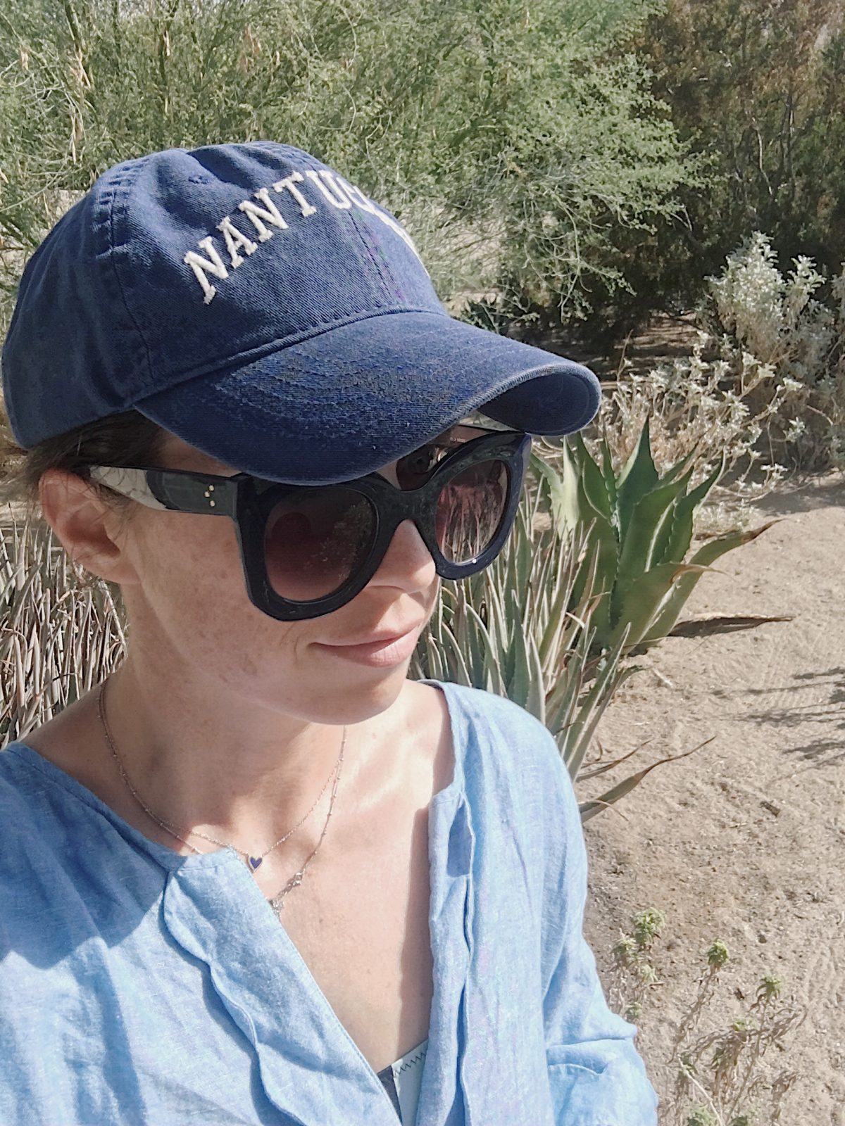 navy butterfly sunglasses and nantucket hat