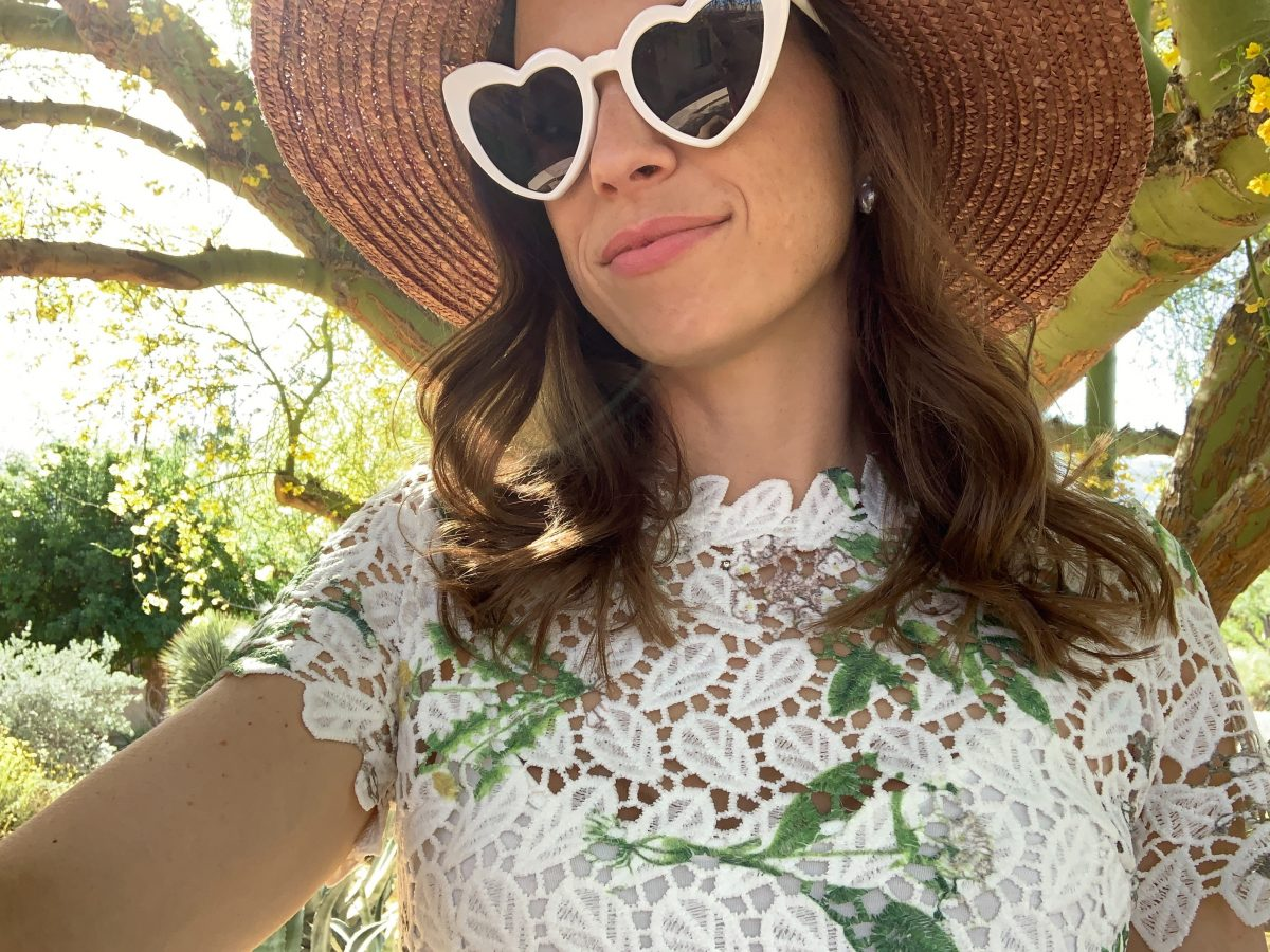 white lace dress and white sunglasses