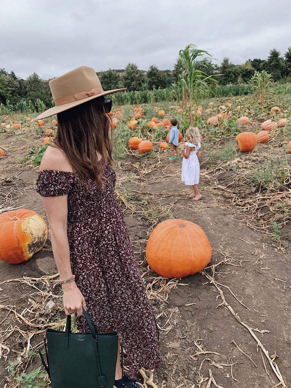 mom and kids in pumpkin patch