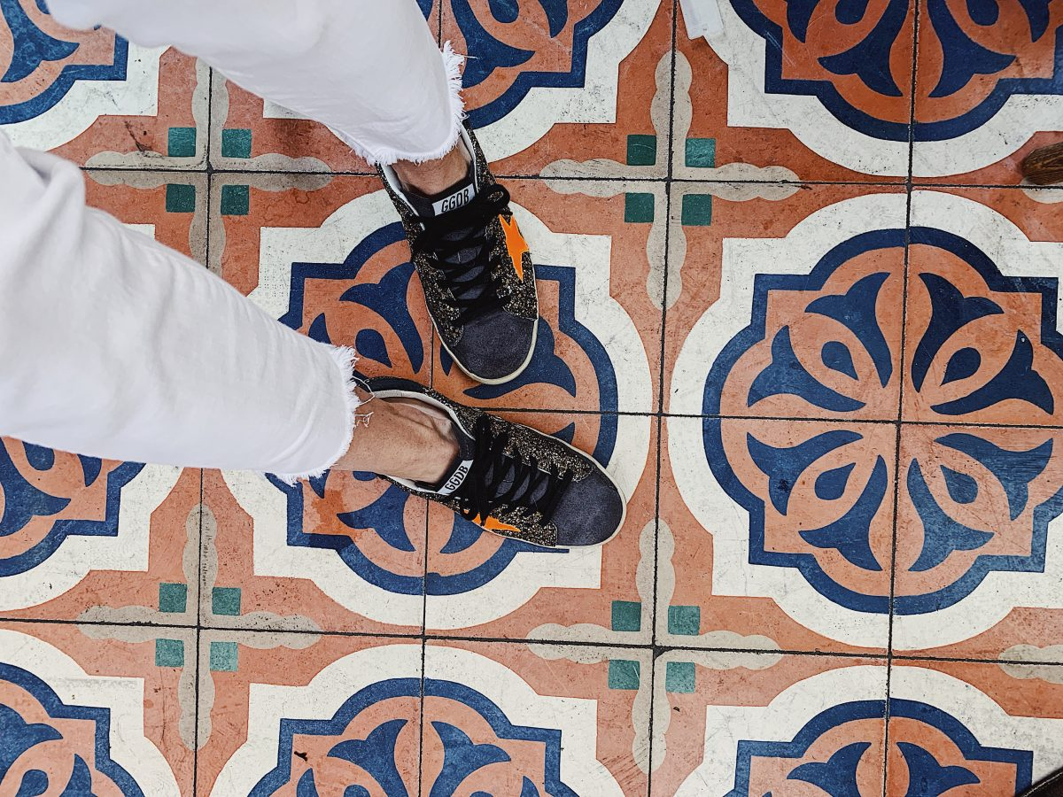 golden goose sneakers with tile floor